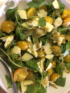From plot to plate - rocket, watercress and spinach leaves with cheddar cheese, 'sunbaby' tomatoes and a pesto dressing